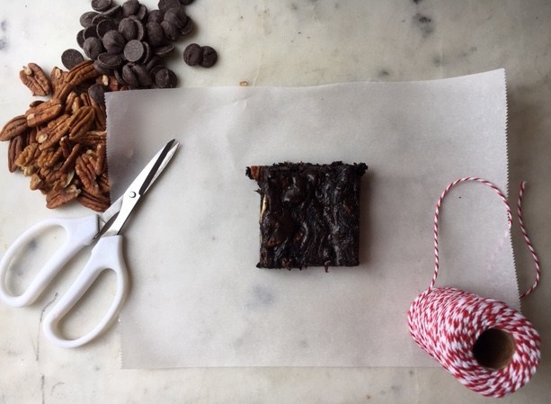 Single chocolate brownie on a parchment square.