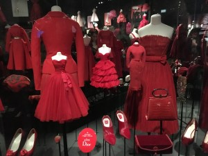 An assortment of red Dior dresses.