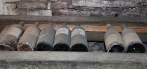 Old dusty wine bottles Burgundy, France.