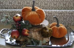 Velvet pumpkins on a silver tray.