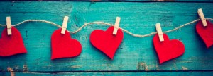 Red hearts on a teal background