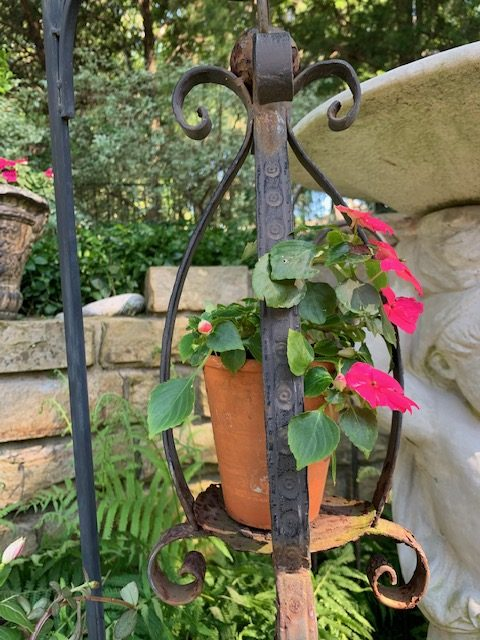 Garden lantern with pot and flower