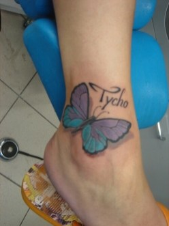 Very nice 3D butterfly tattoo design on ankle with name