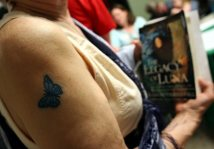 Cute - love it ! I was wondering if tattoo have something to do with the book that Lady is holding :)