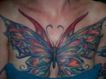 Another example of very big butterfly tattoo on chest - blueish