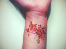 Colorful flower tattoo on wrist 06