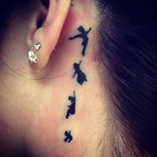 Peter Pan tatoo behind ear