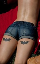 Batman tattoo on the back of a thigh http://www.3d-tattoodesign.com/hebrew-lettering-body-thigh-tattoo-designs-women/