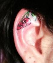 Skull like cherries tattoed on ear http://www.tattoospictures.us/cute-ear-tattoos-for-girls.html