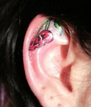 Skull like cherries tattoed on ear http://www.tattoospictures.us/cute-ear-tattoos-for-girls.html