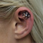 Small cute tattoos on earlobe