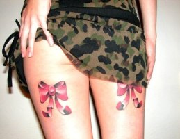 Pink And Black 3D Bow Tattoo On Back Thigh https://www.askideas.com/24-mind-blowing-bow-tattoo-images-gallery/