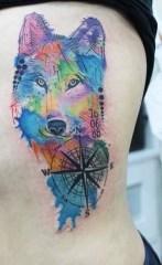 Fantastic Watercolor Tattoo On Ribs. http://www.tattoobite.com/fantastic-watercolor-tattoos-on-ribs/