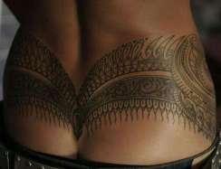 Lower back Polynesian tribal tattoo https://www.gettattoosideas.com/lower-back-tattoos/