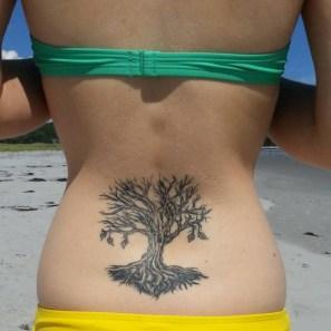 Tree with roots tattoo https://tattoorevolution.com/lower-back-tattoos/