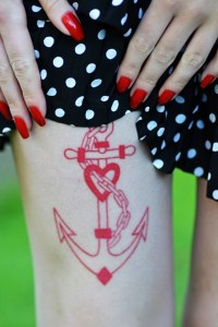Red sexy anchor on pale skin http://tattooton.com/100-sexy-thigh-tattoos-for-women-in-2016/