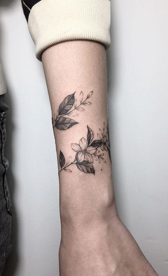 Amazing flower wrist tattoo design for women