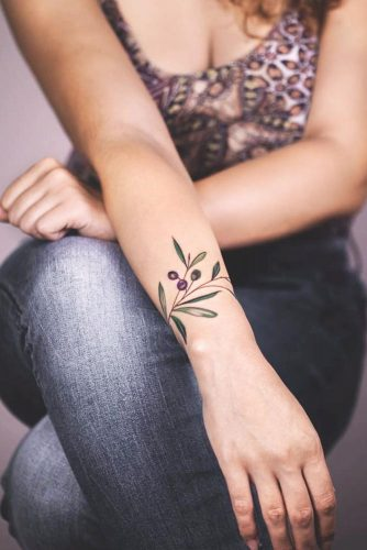 Delicate bracelet berries leaves tattoo