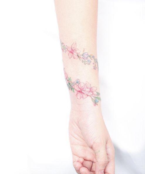 Delightful wrist armband tattoo design for girls