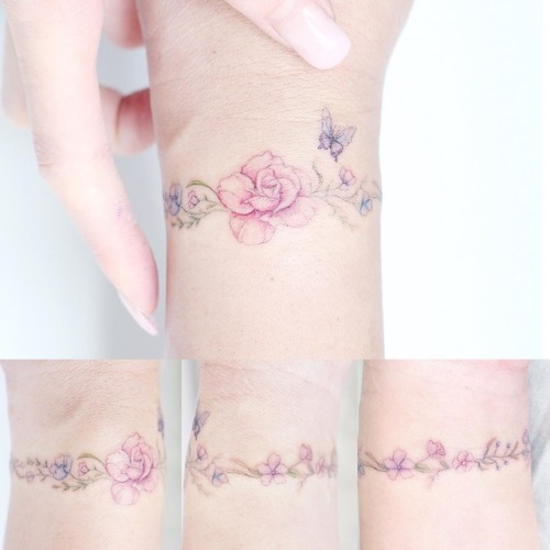 FlowFlower and butterfly armband tattoo on wrist