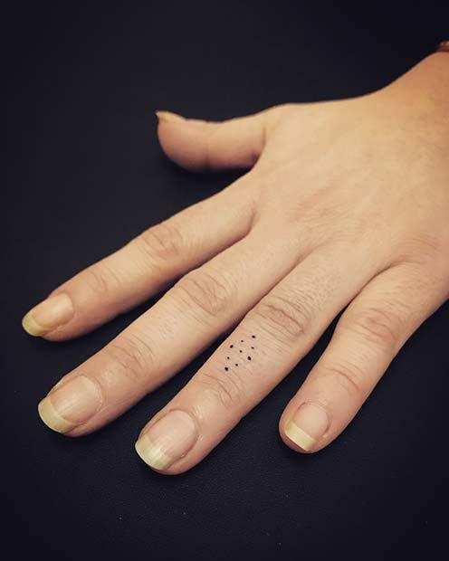 Stylish symbol dots finger tattoo