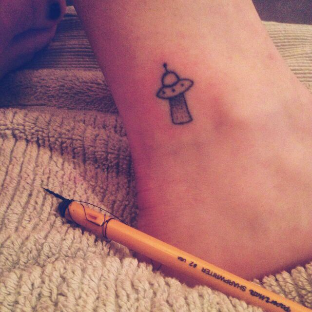 Beautiful ankle spaceship tattoo for women