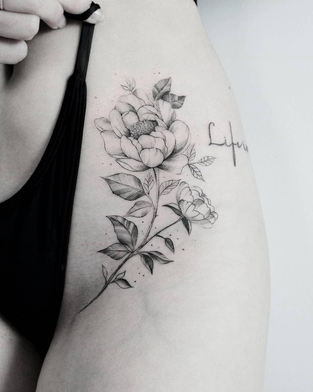 Small flowers on women thigh tattoo ideas