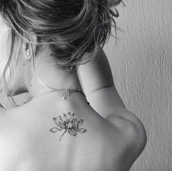 Best lotus flower tattoo on the back of the neck