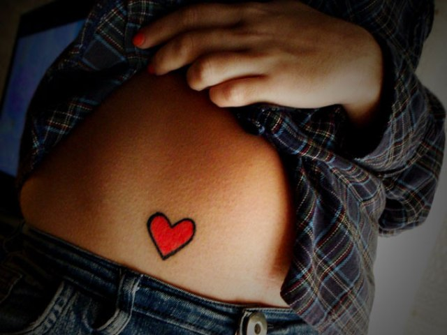 Bright red heart tattoo for women