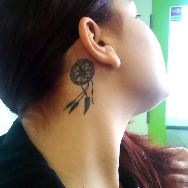 Dreamcatcher behind tattoo for women