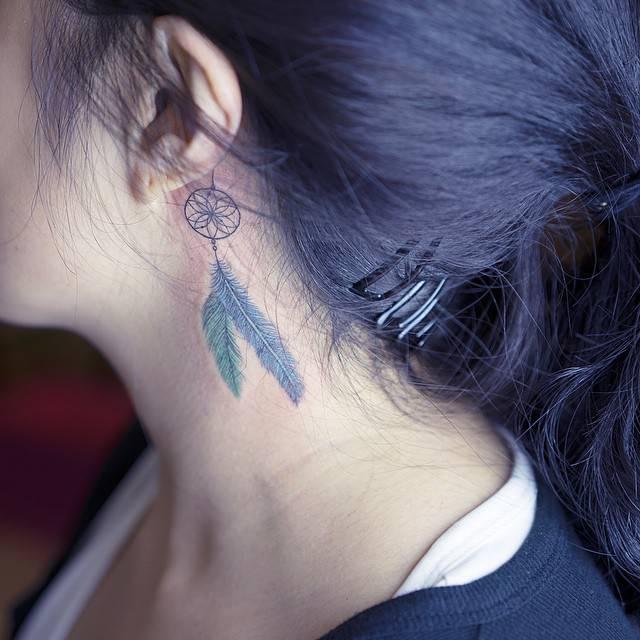 Elegant dream catcher tattoo behind the ear