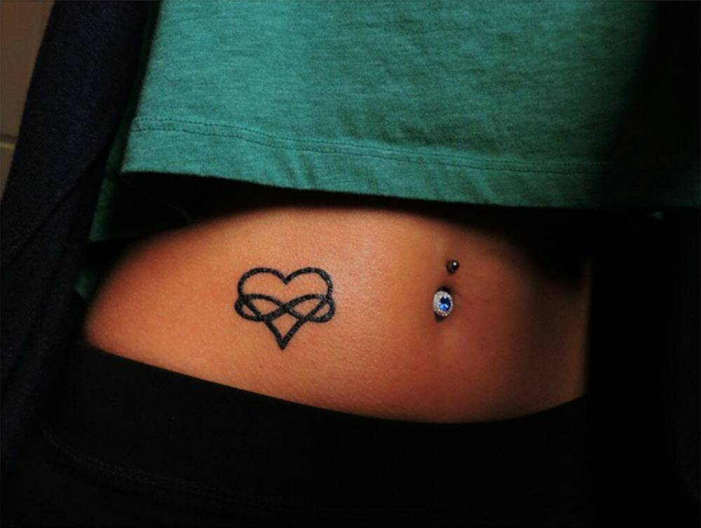 Heart and the sign of infinity tattoo for women