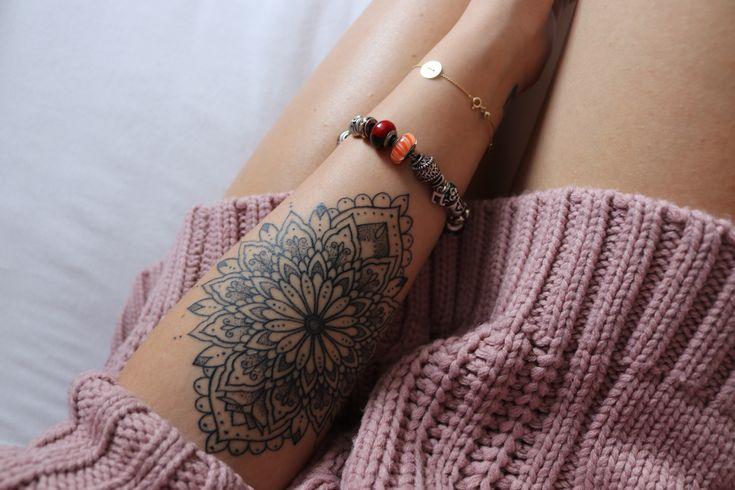 Mandala symbol tattoo on women arm ideas