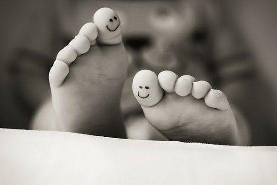Smile tattoo under toe