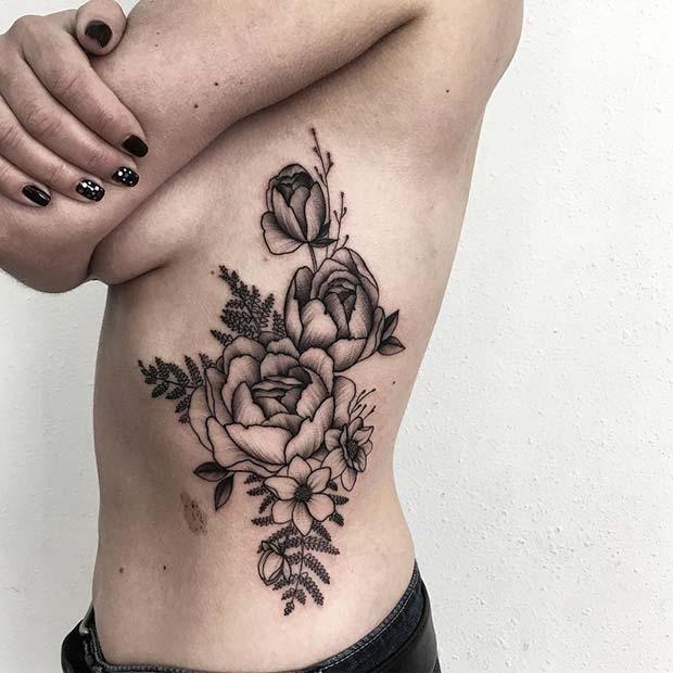 Beautiful floral rib tattoo