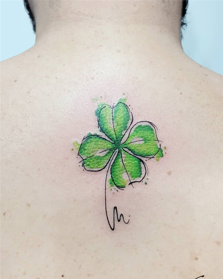 Colorful four leaf clover tattoo on back