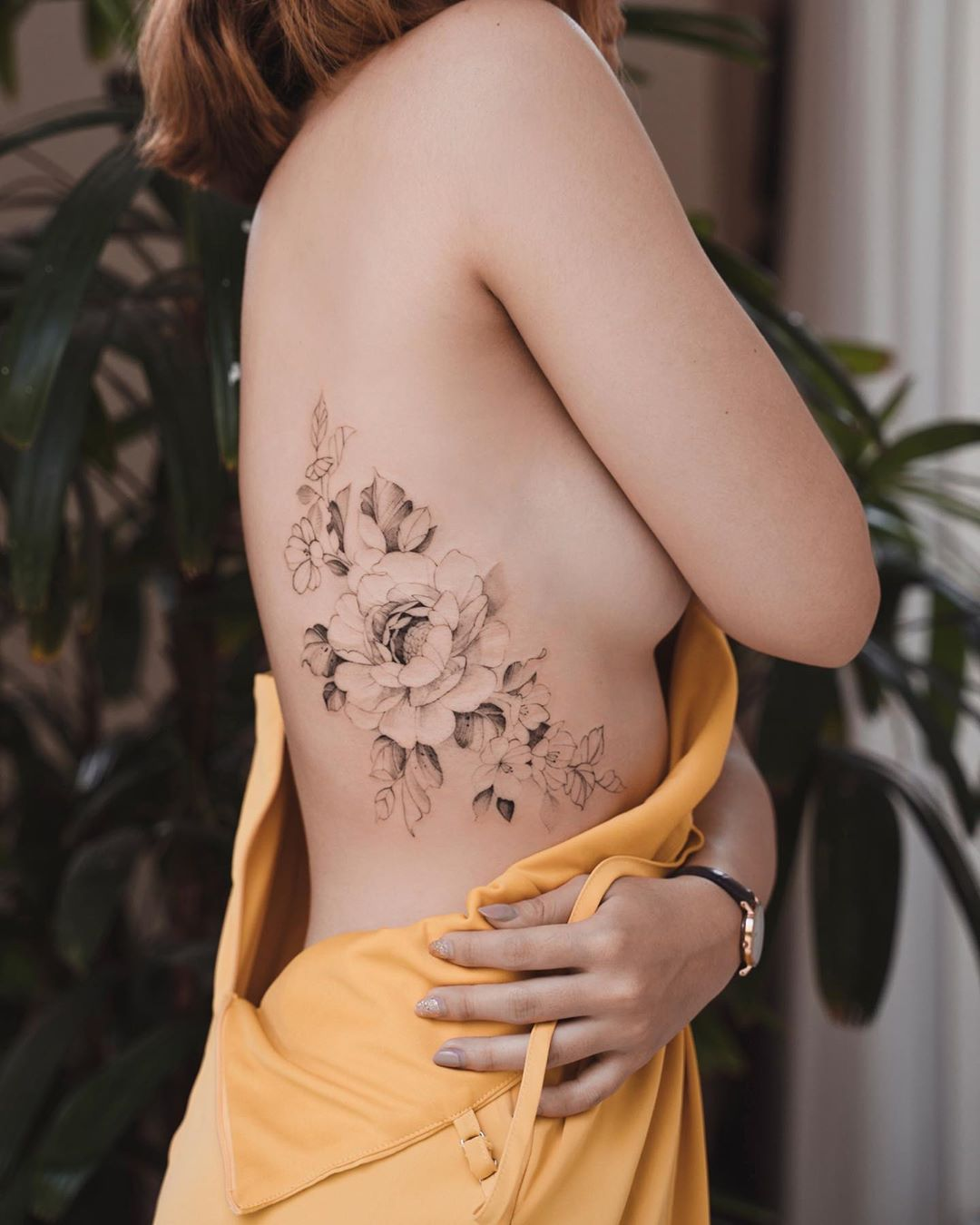 Incredible floral rib tattoo for women