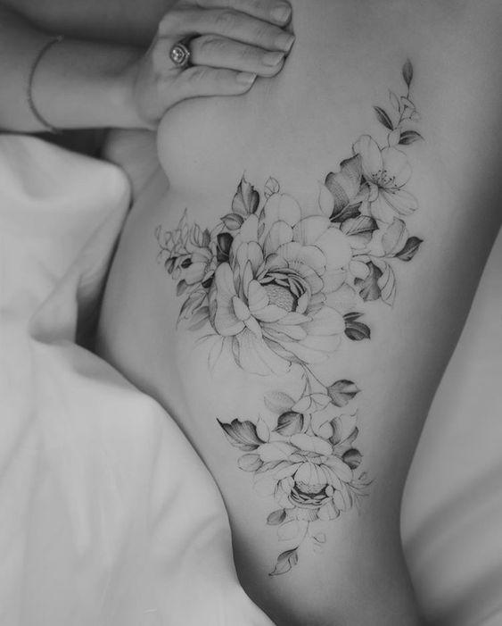 Most eye catching floral rib tattoo