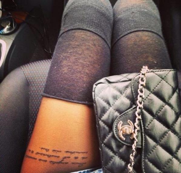 Sexy script thigh tattoo