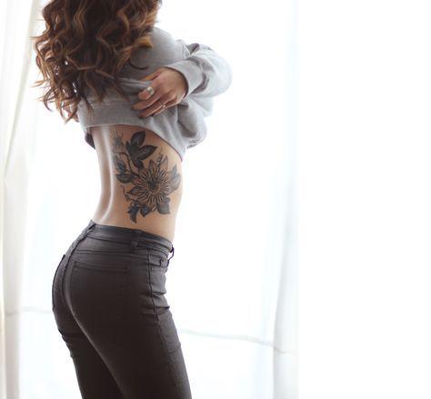 Wanderlust flower tattoo on women rib bone