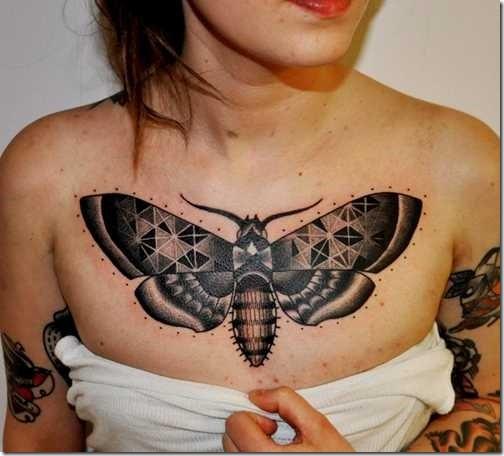 Black butterfly tattoo on women chest