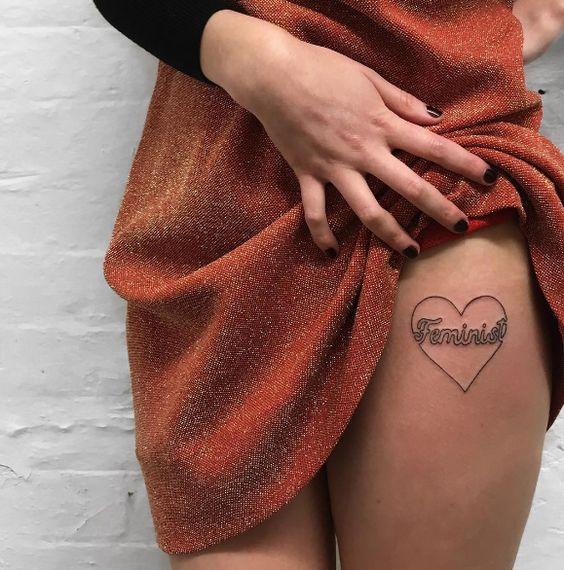 Feminism tattoo for girl on leg