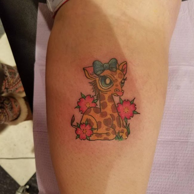 Funny cute giraffe tattoo