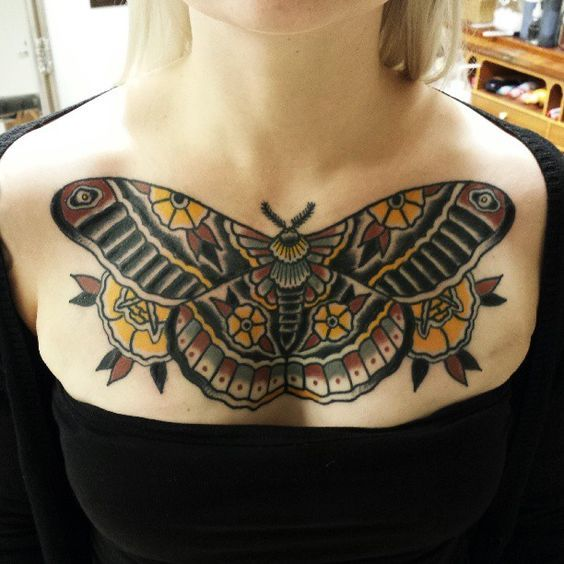 Yellow and brown moth tattoo on chest