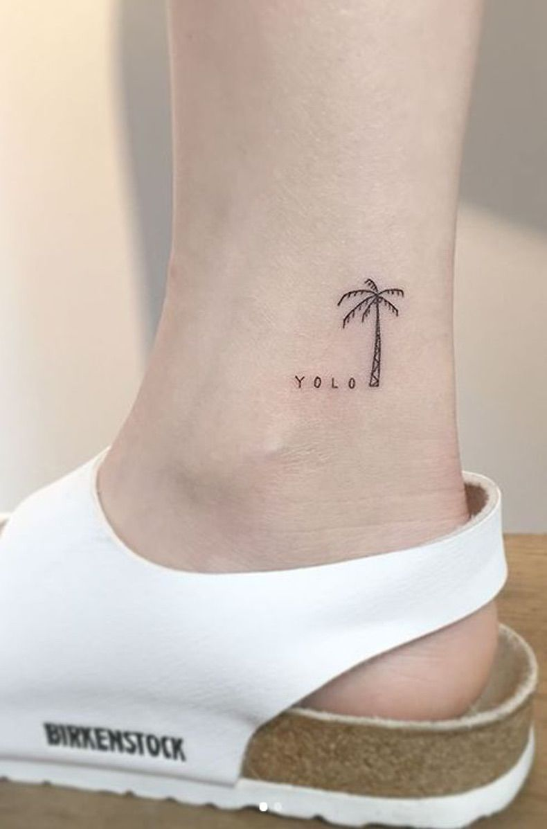 Lovely yolo palm tattoo for girl