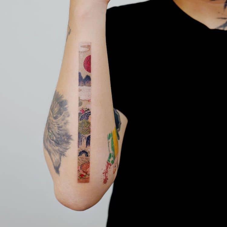 Memory frame tattoo on forearm
