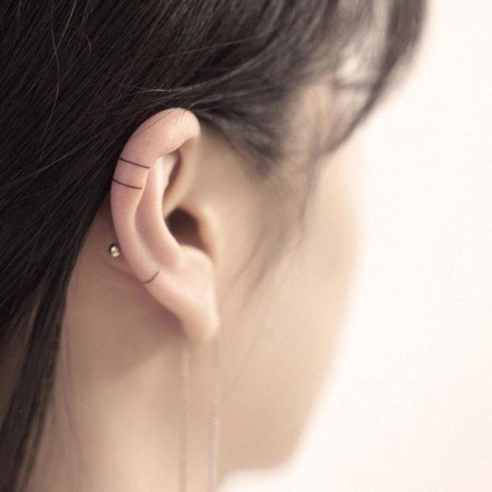 Minimalist line tattoo on ear