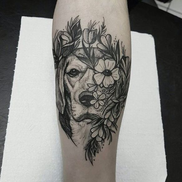 Dog and flower tattoo on arm