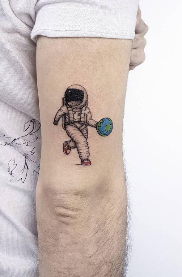 Astronaut playing basketball tattoo