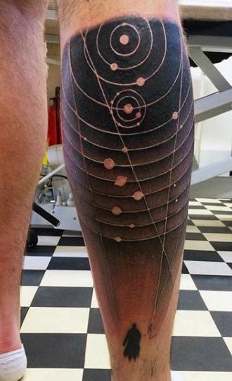 Back of leg astronomy tattoo
